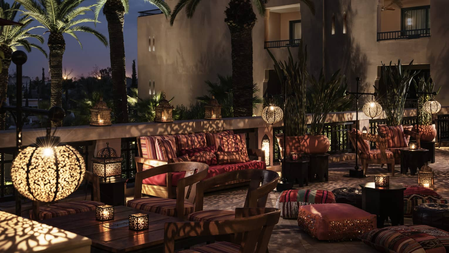 Inara Lounge dimly-lit patio seating areas with lights, shadows from Moroccan lamps