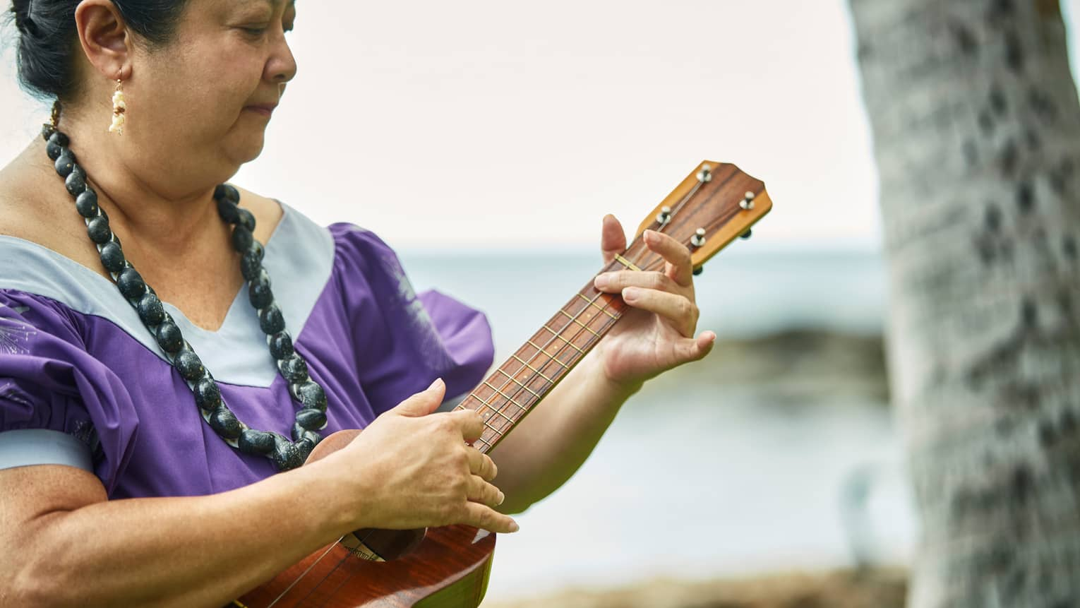 Hawaiian native playing a ukulele