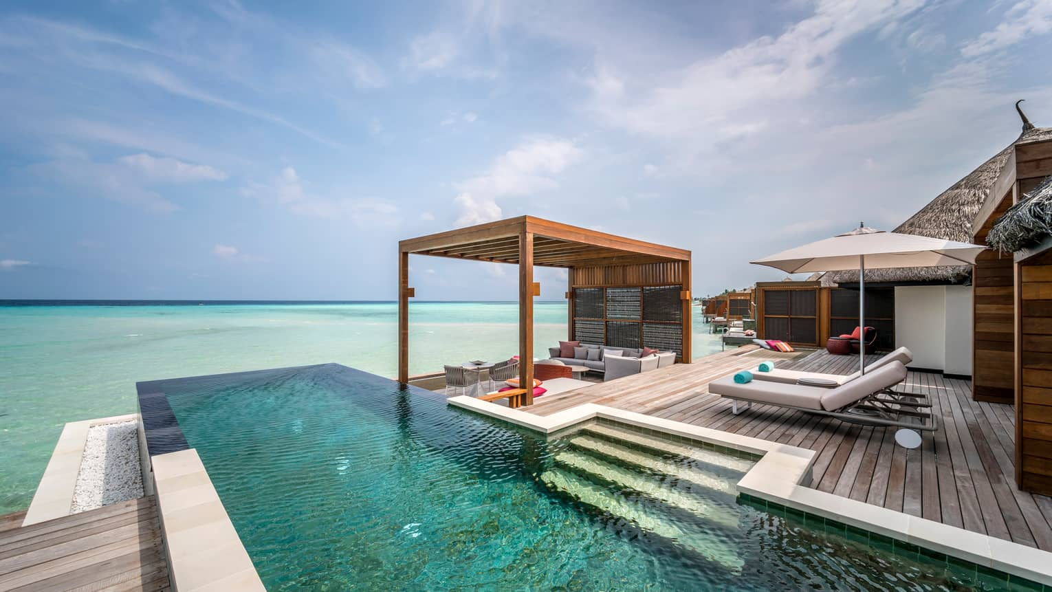 The two-bedroom water suite's extended deck with private pool and shaded lounge area