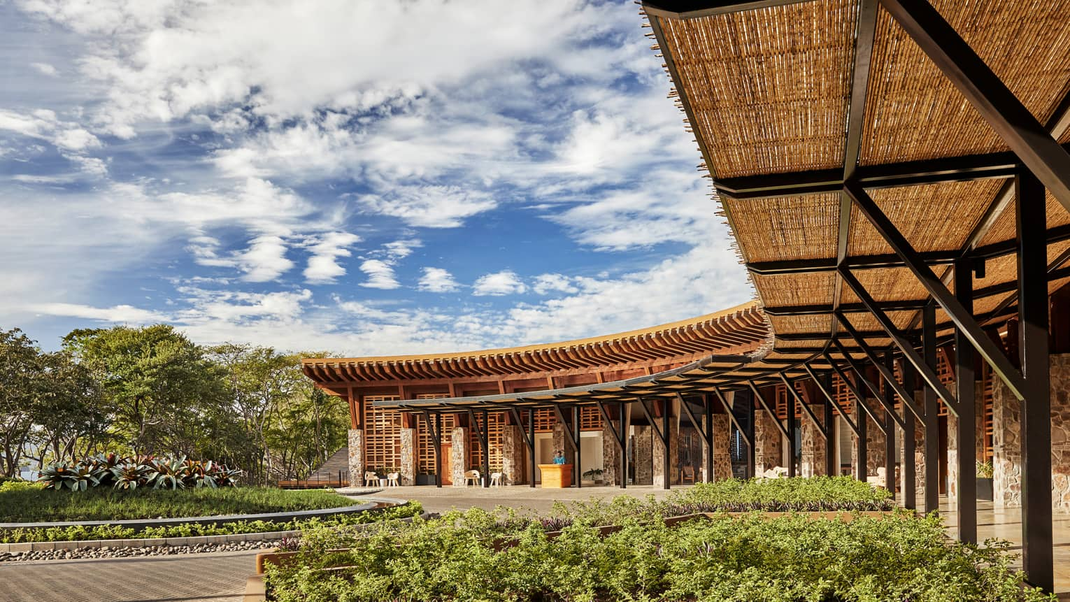 Curved rattan roof, pillars over Four Seasons Hotel Costa Rica at Peninsula Papagayo front entrance