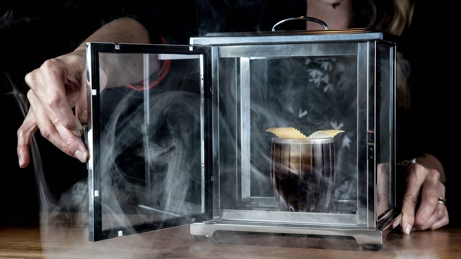 The Spirit of the Mountains specialty cocktail is served in a special container filled with swirling fog