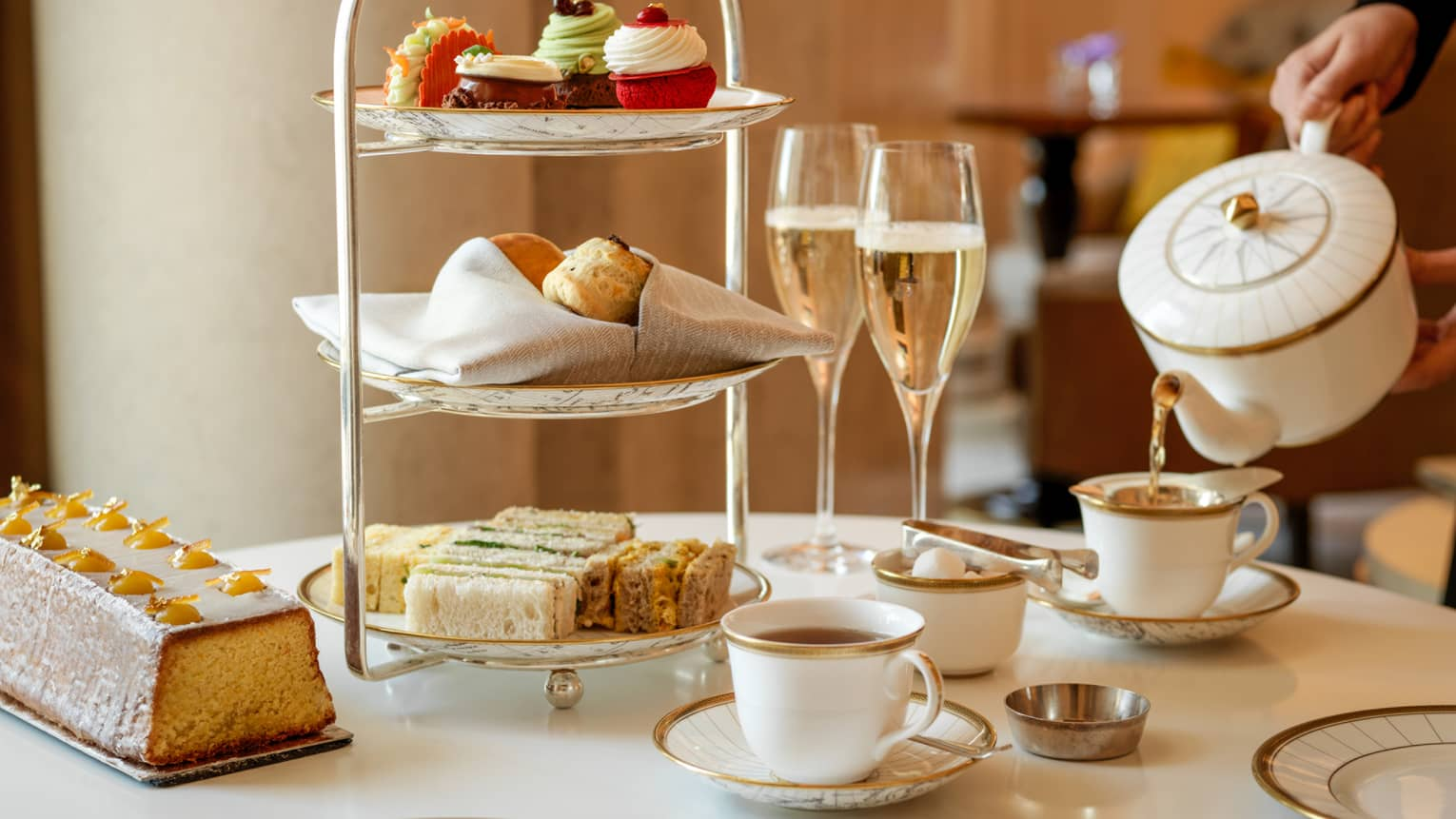 Afternoon tea with pastries and champagne in Rotunda Lounge
