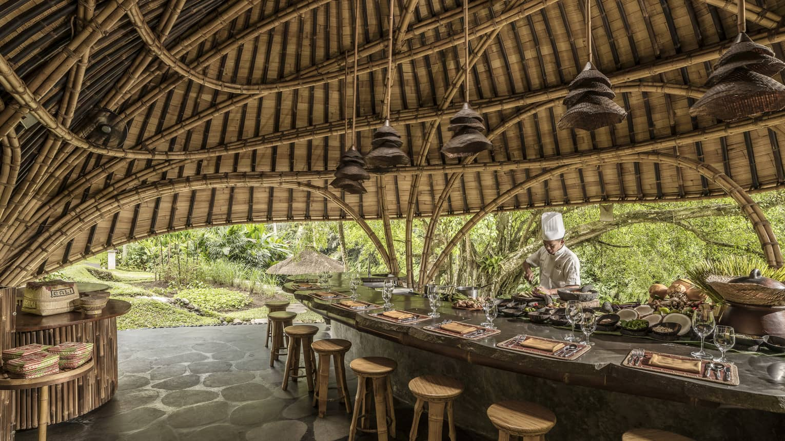 A chef prepares for Sokasi Cooking School in a bamboo pavillion