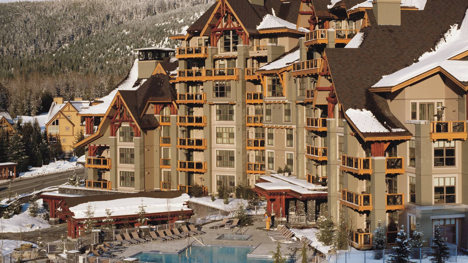 Exterior view of Whistler mountain resort building, pool area