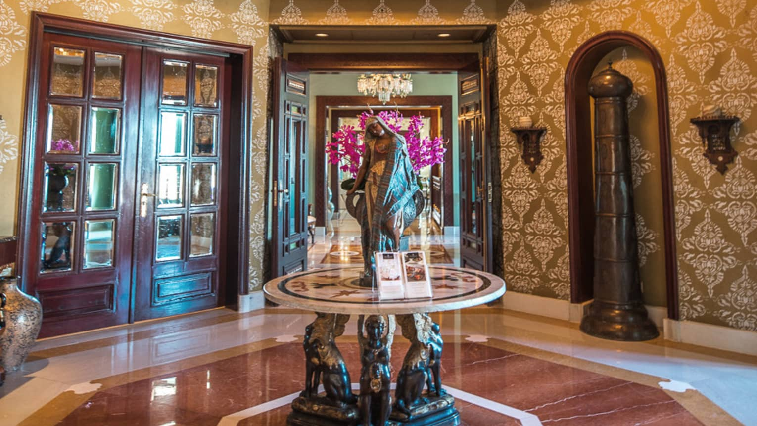 an empty ornate-styled lobby in four seasons alexandria
