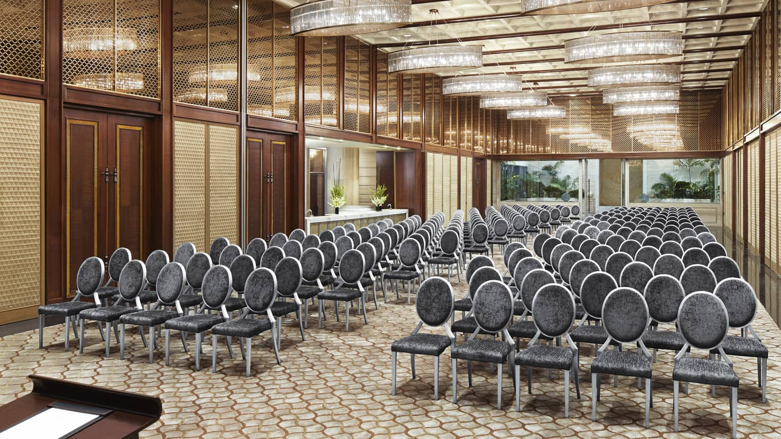 Rows of meeting chairs facing podium in long Gallery ballroom