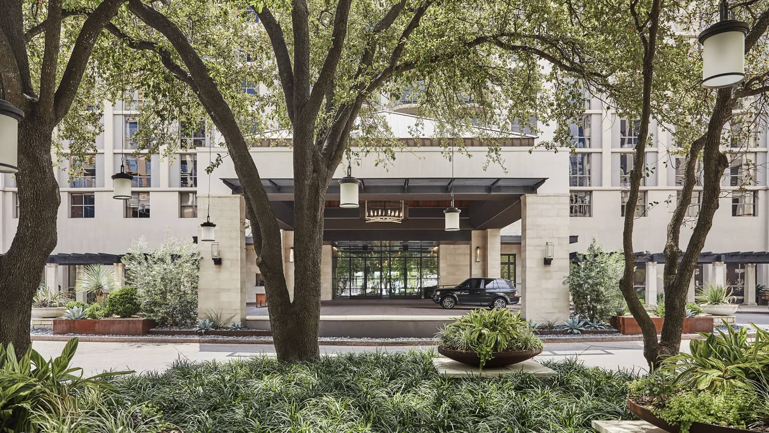 Trees line the entrance to the Four Seasons Hotel in Austin