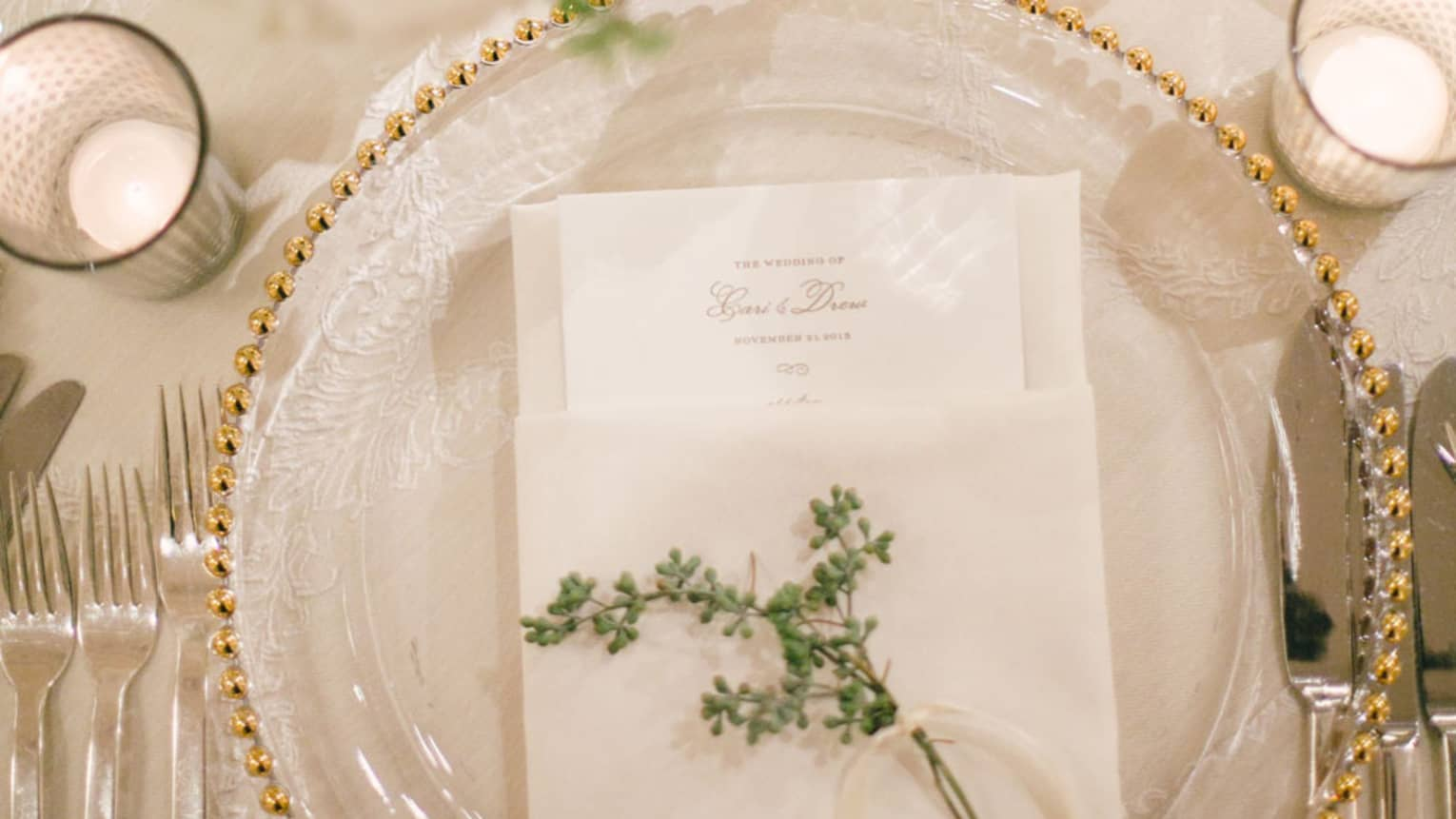 Wedding table setting with menu and flower on plate