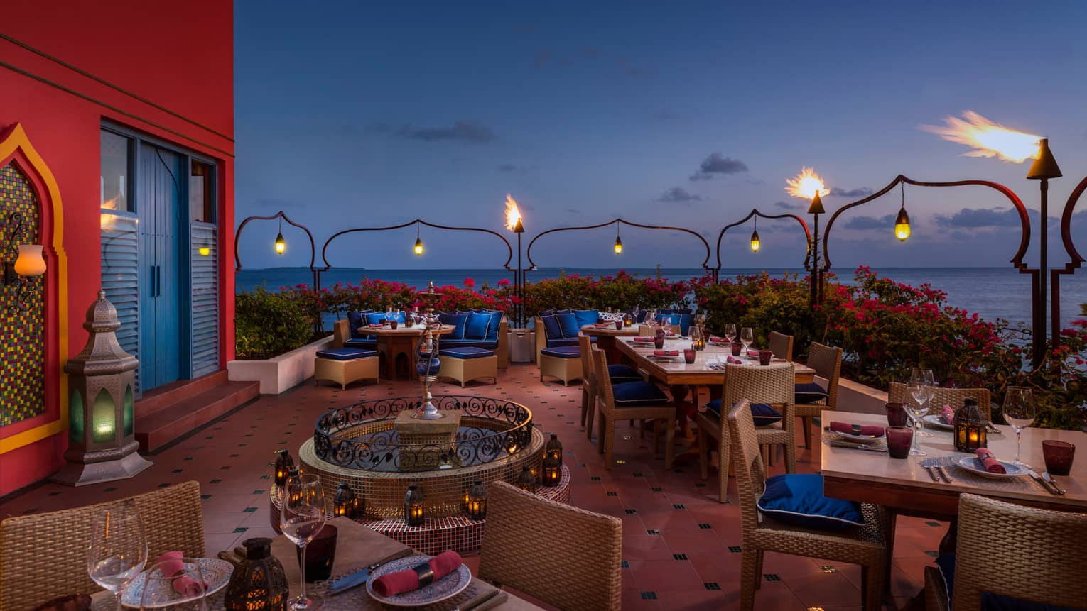 Al Barakat elegant rooftop shisha  bar with glowing lanterns, tile fountain, deep red and blue decor