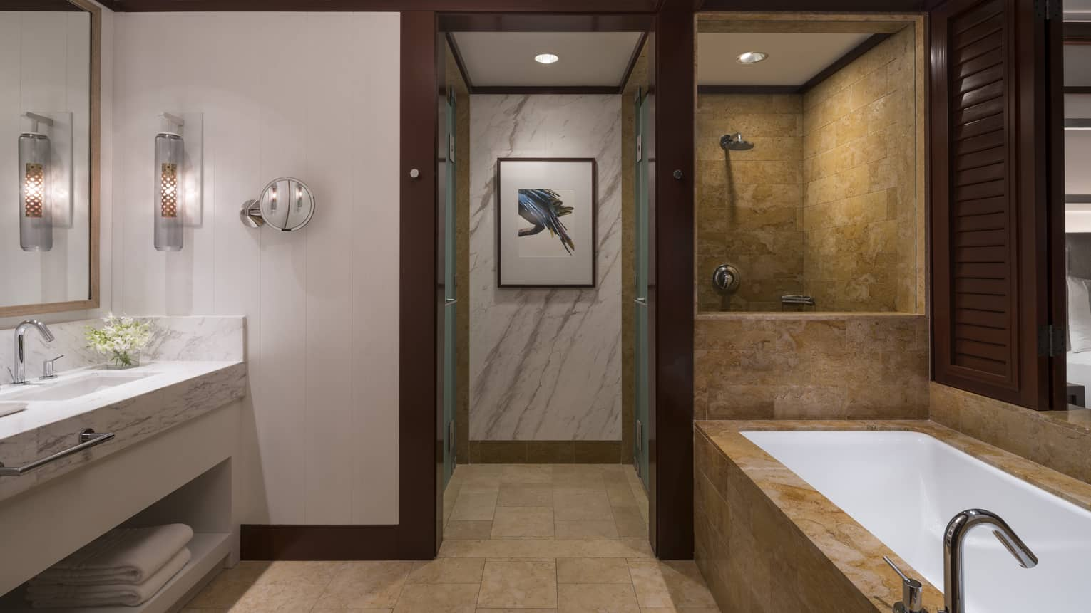 Bathroom Interior Featuring Bathtub, Shower, Sinks, and Interior Hallway