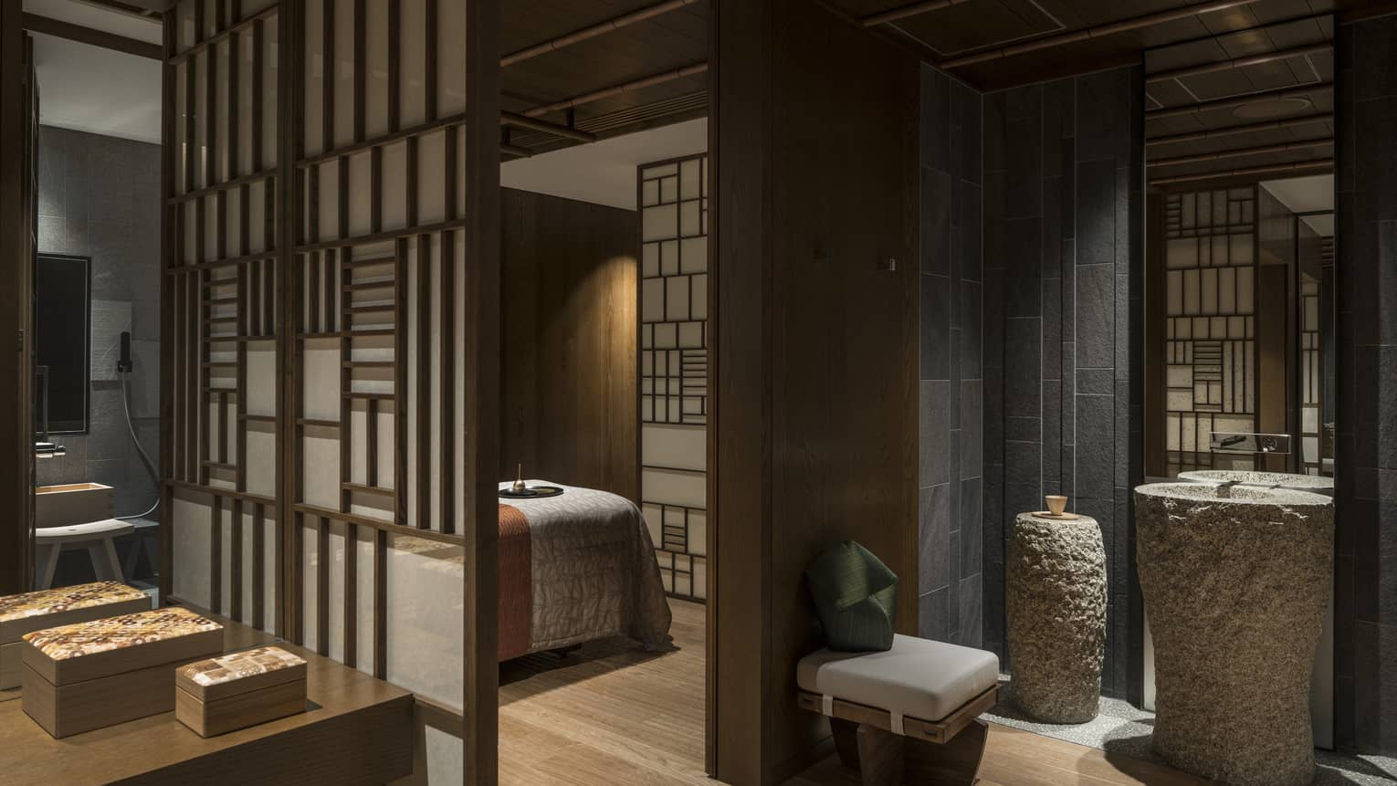 Spa treatment rooms behind screens, large stone vases
