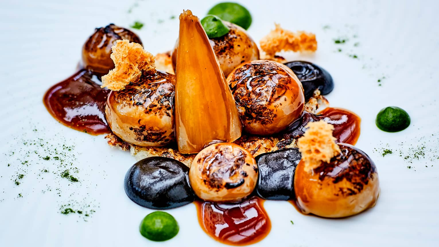 Close-up of roasted Gratinated Onions in sauce