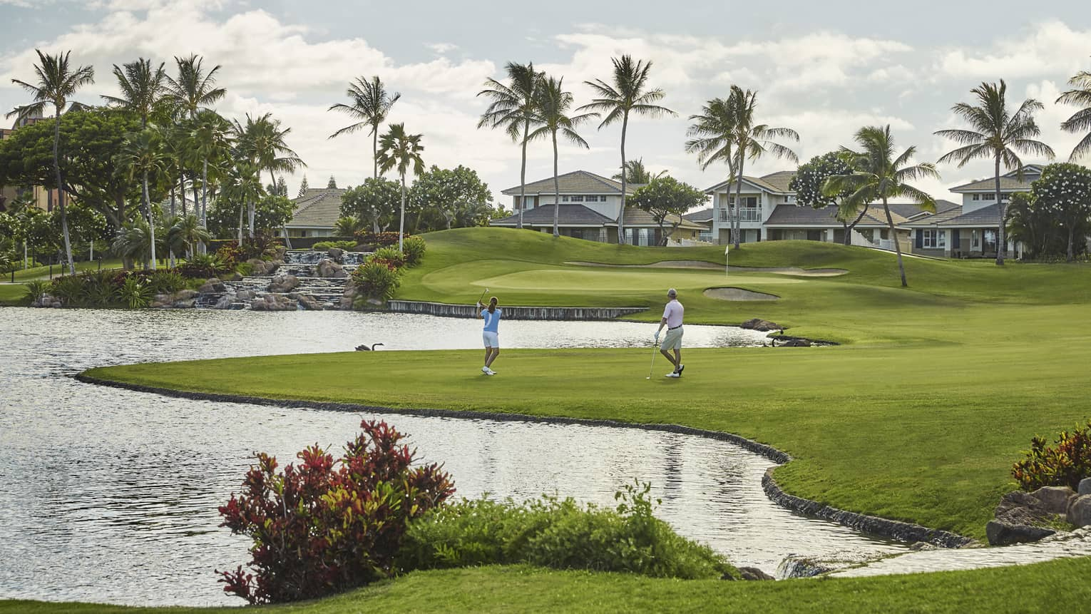 Two golfers playing on the Ko Olina course