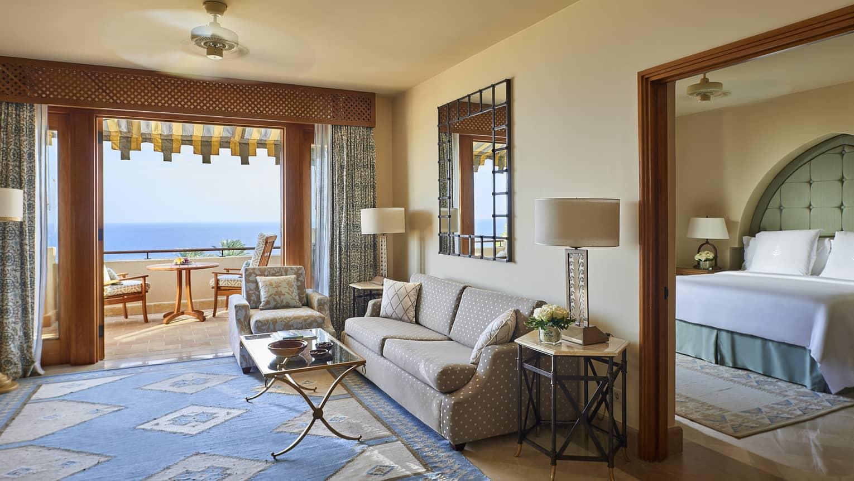 One bedroom suite seating are between large open doors to patio, bedroom