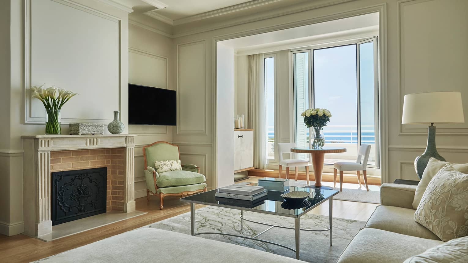 Palace Sea-View Suite, sofa, armchair under high ceilings, fireplace, window alcove with dining table