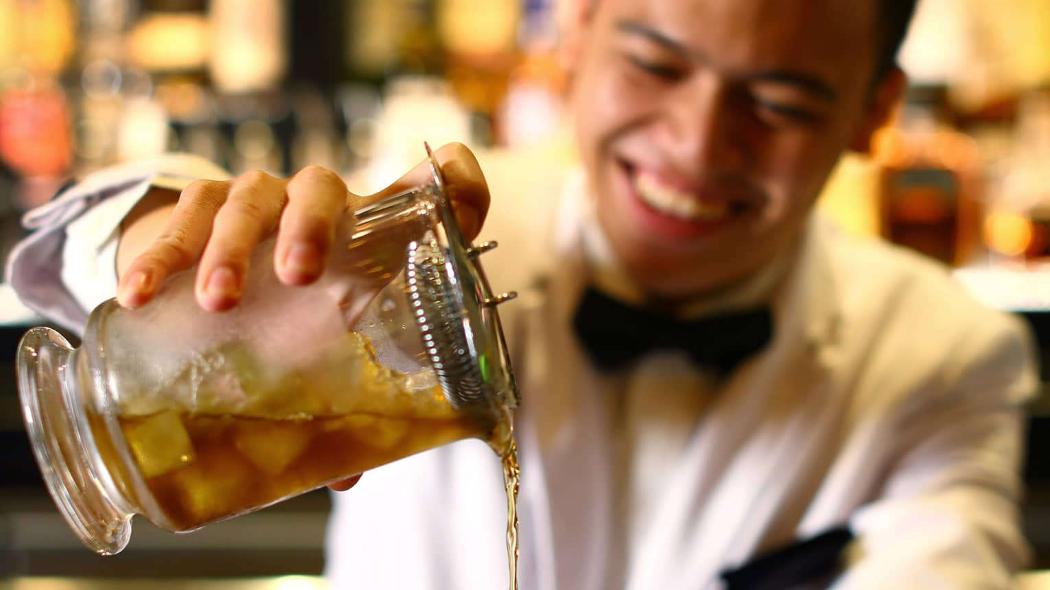 A bartender pours a drink at a Jakarta Hotel bar