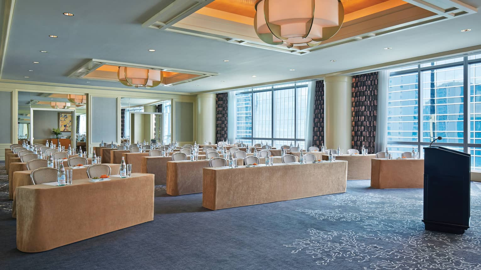 Rows of meeting tables in bright function room