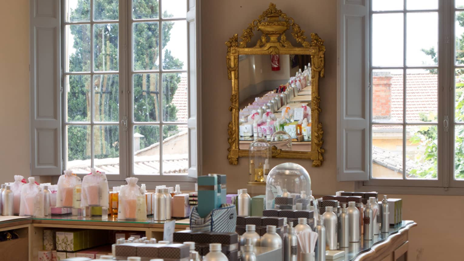 Fragonard parfumerie with fragrance bottles lining table
