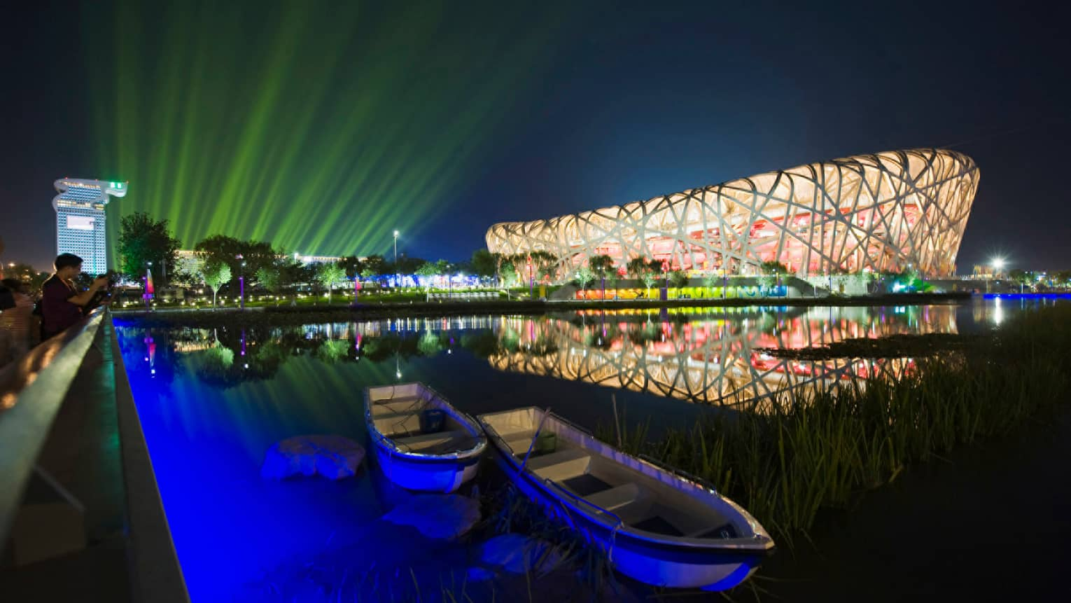 Exterior of Beijing National Stadium bird's nest-shaped building lit up at night