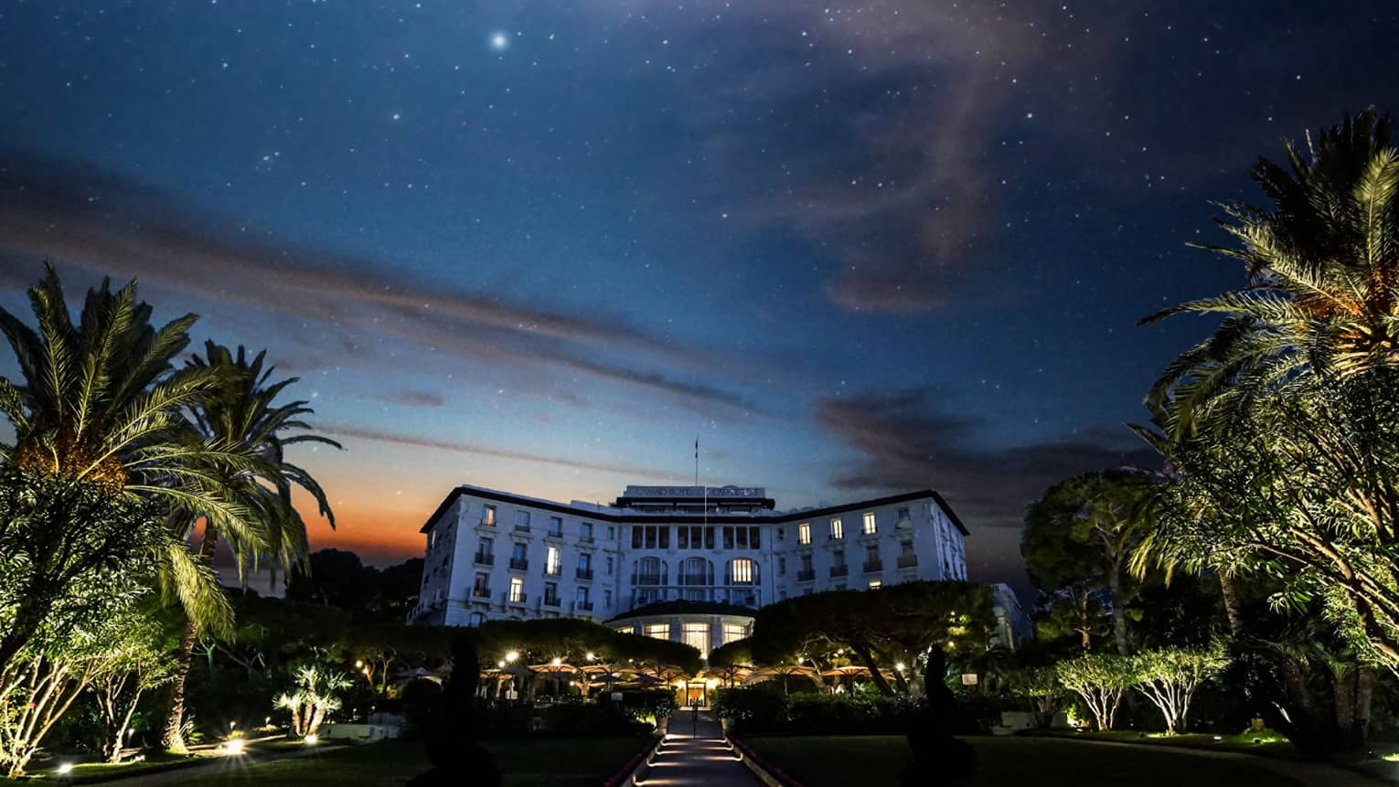 Starry sky, palm trees above Four Seasons Grand-Hotel du Cap-Ferrat