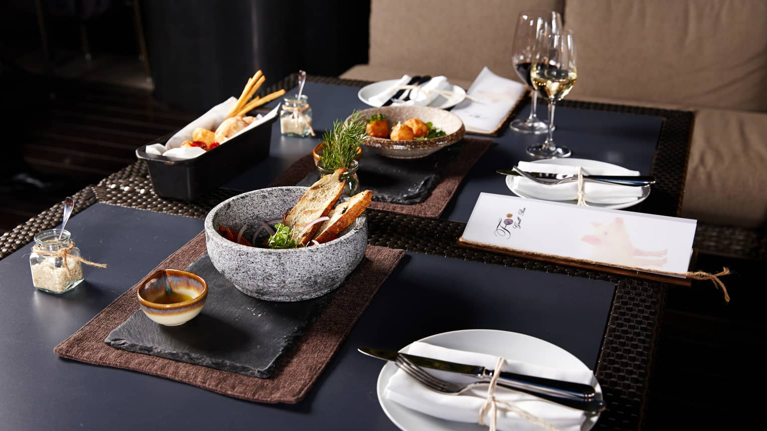 Foo dining table slate platters, bowls with toasts, appetizers