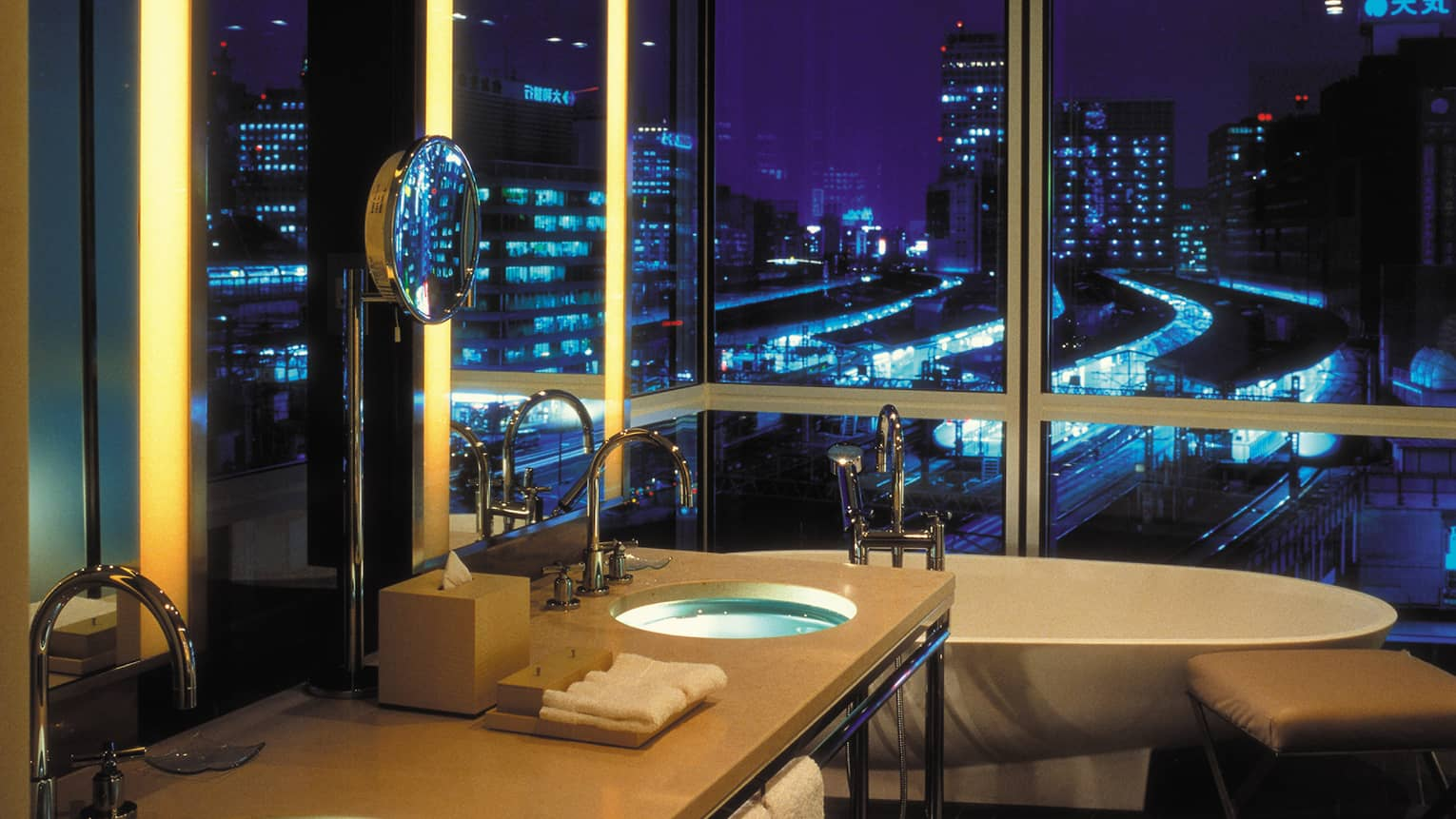 One-bedroom Suite bathroom, sink, freestanding tub by floor-to-ceiling window, Tokyo city lights