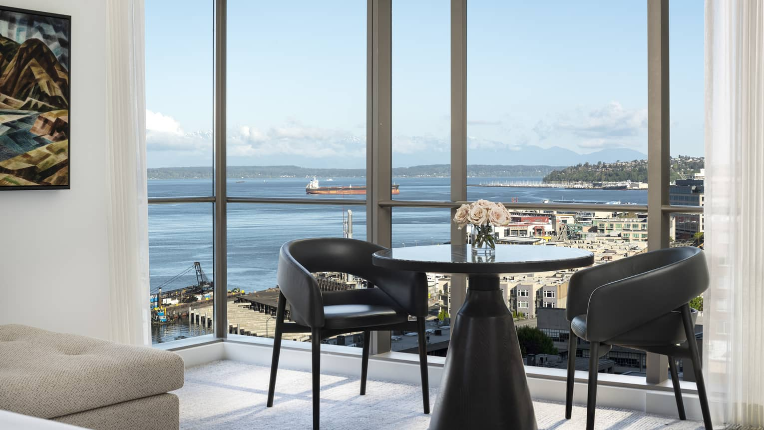 A table in the corner of the Prime Bay View Room overlooks the water and colorful buildings below
