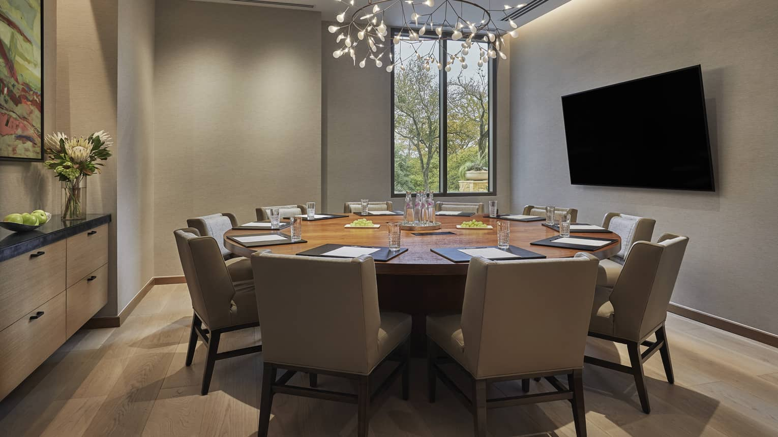 Shoal Creek meeting room with small round table, large chairs, screen