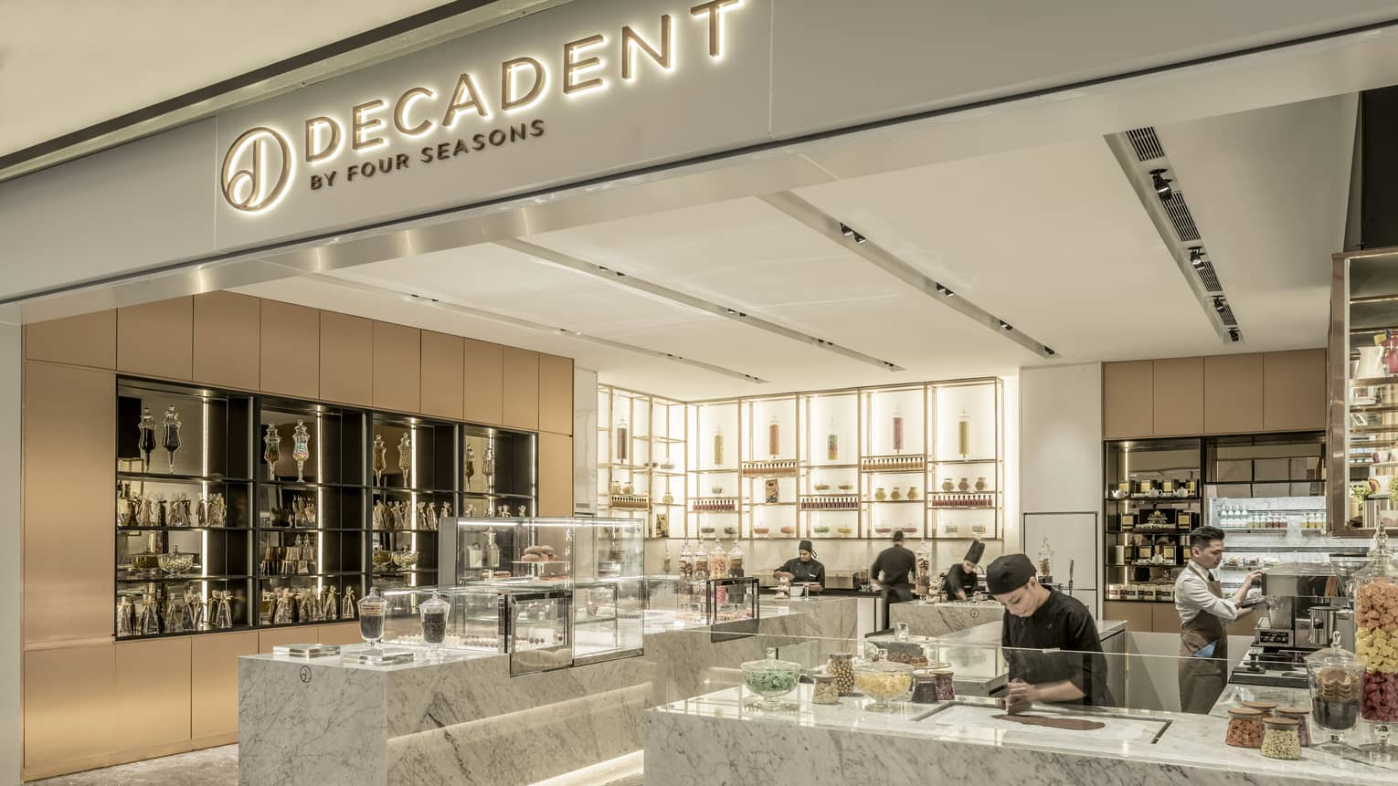 Decadent Mall Outlet, a sweets shop with a chef creating a dessert at the counter