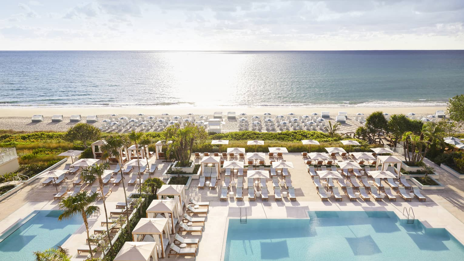 Aerial view of sprawling Four Seasons Resort Palm Beach pool, patio and beach by ocean