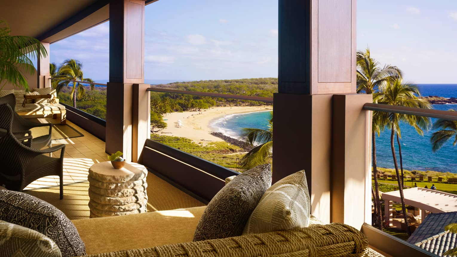 Open-air lanai with sofas, lounge furniture overlooking beach, ocean
