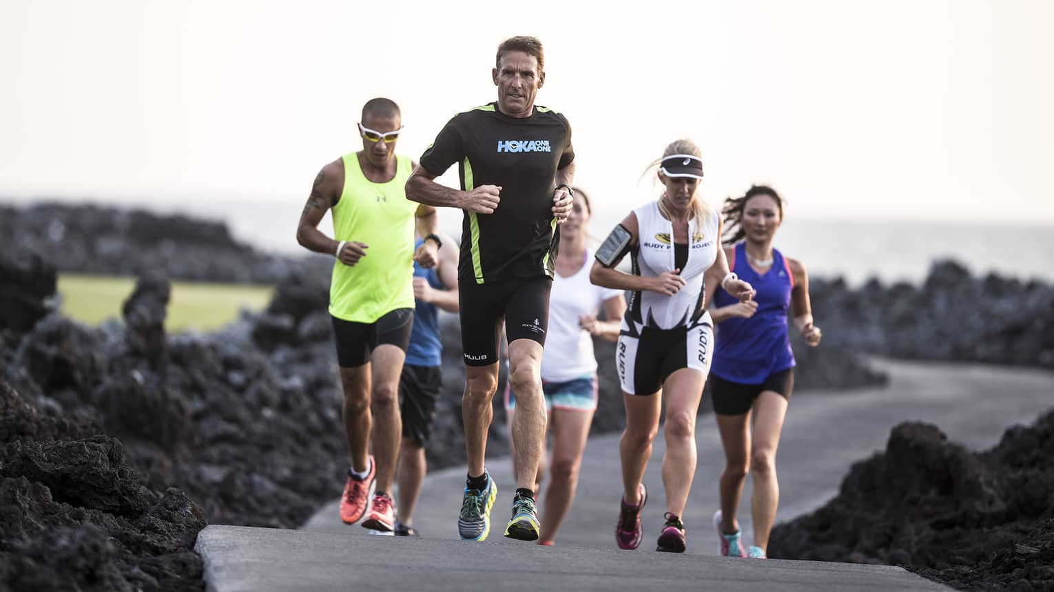 Guests running past volcanic ash with Dave Scott for his specialty triathlon training
