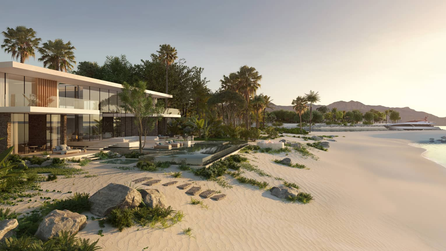 Modern two-storey residence in front of white sand beach, ocean at sunset