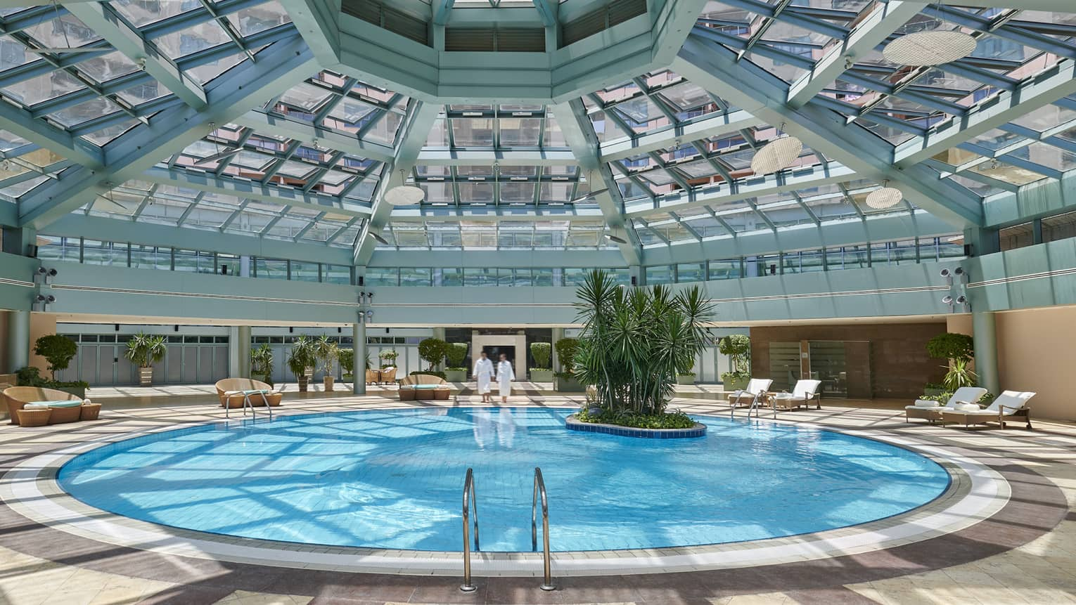 Skylights pour in natural light over the indoor pool at four seasons hotel alexandria