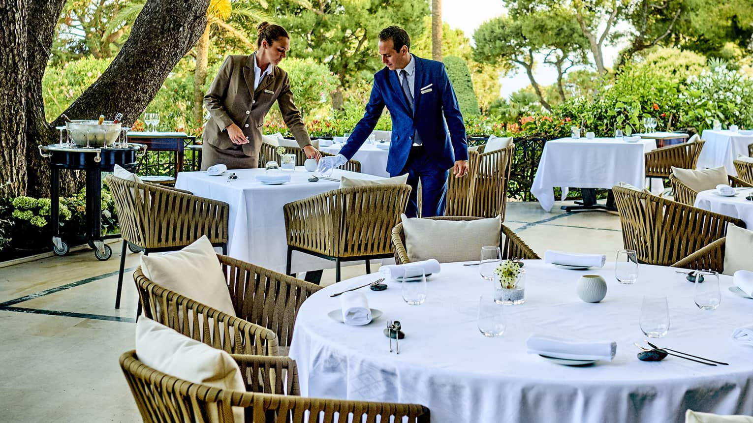 Le Cap terrace with tables covered in white tablecloths and with light-brown chairs