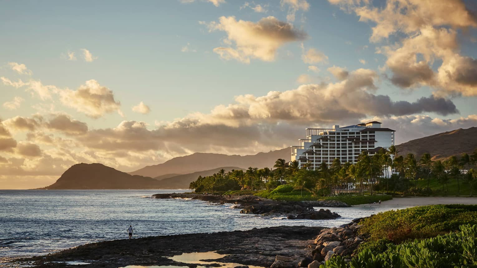Sunset Over Four Seasons Resort Oahu Building On Rugged Coast Waianae Mountains
