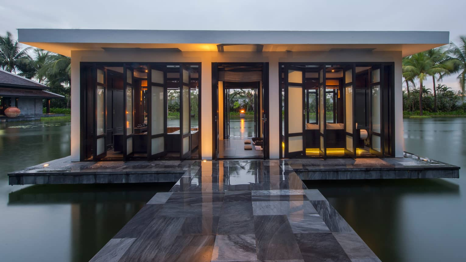 Marble tiles over lotus pond to The Heart of the Earth spa