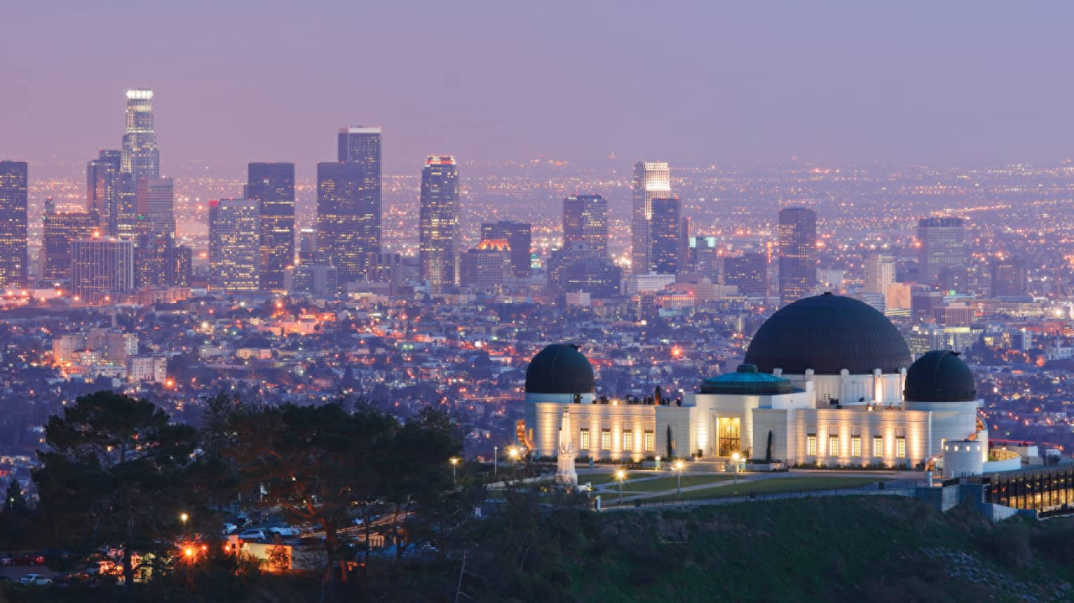 Griffith Observatory domed building, lights on hill overlooking Los Angeles at night