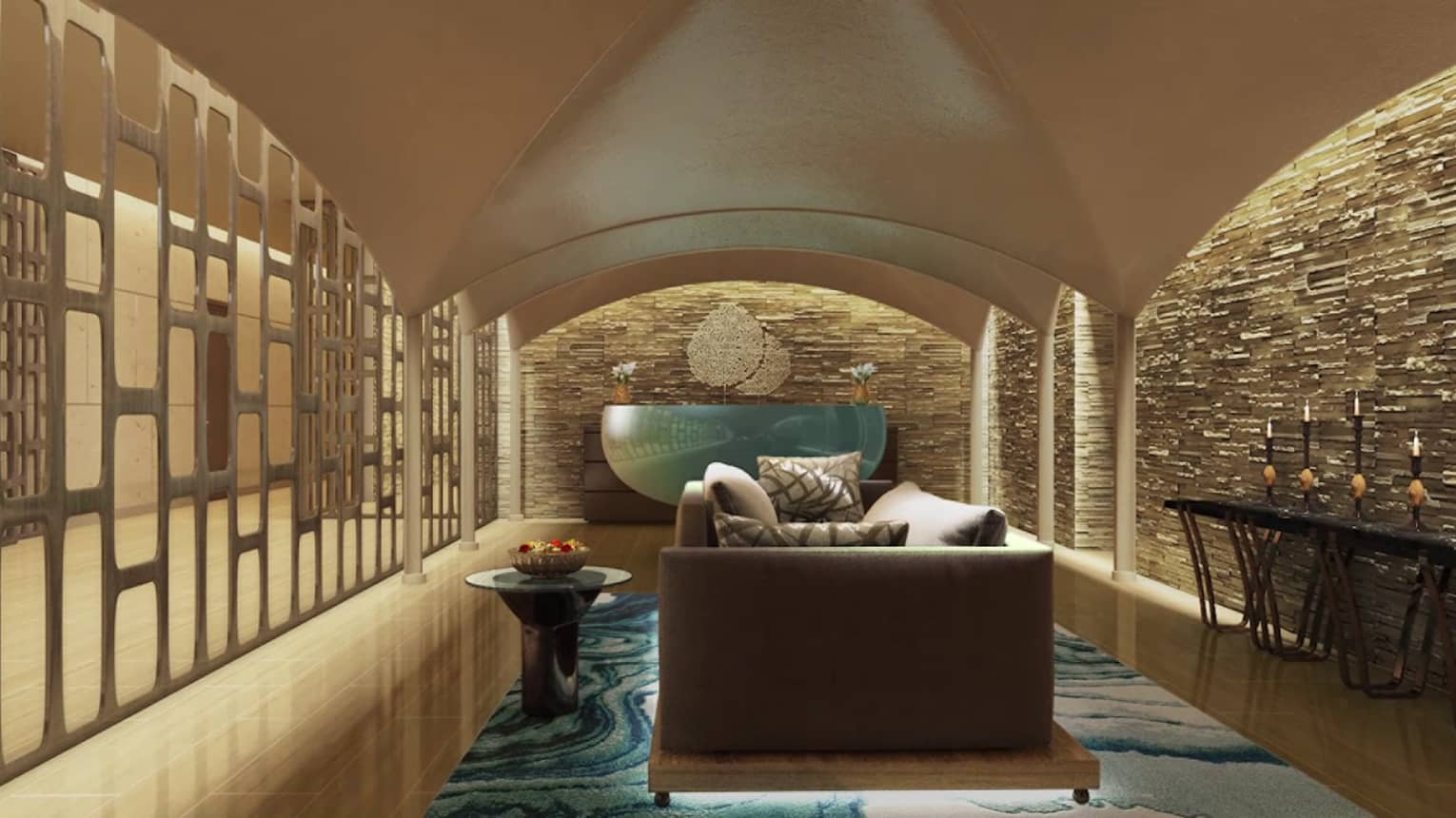Infuse Spa modern lobby. sofa between accent and stone tile walls
