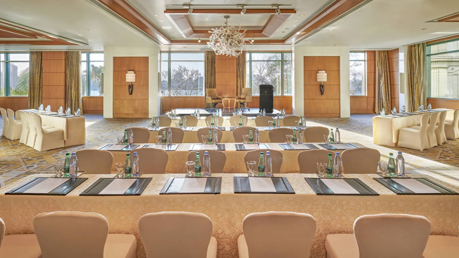 Bright Nile Ballroom with rows of conference meeting tables and chairs