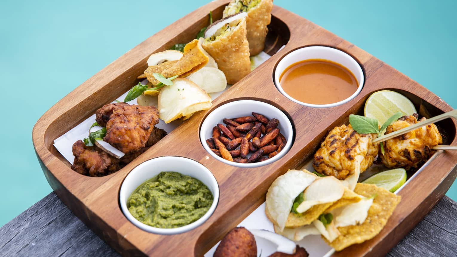 A bamboo tray of an assortment of finger food from the Sunset Bar
