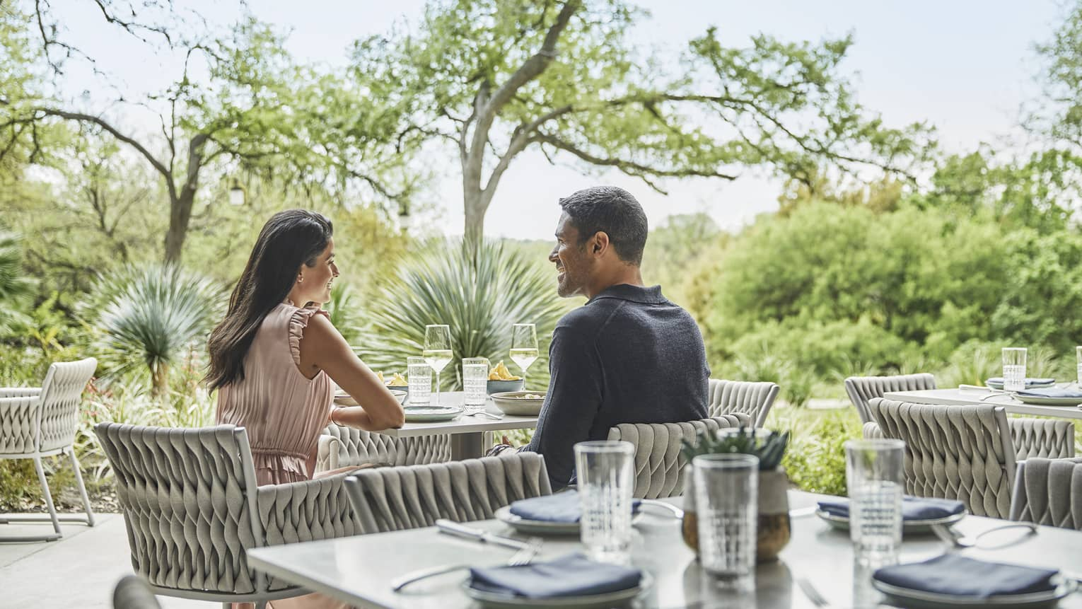 A couple shares a romantic meal on the outdoor terrace at Ciclo.