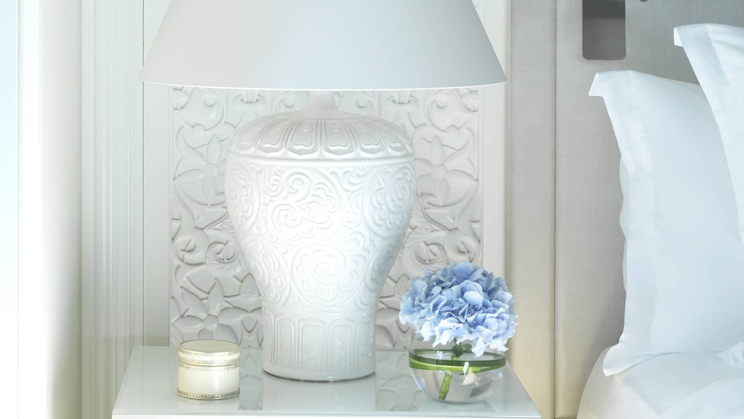 Guest room nightstand, with a white lamp and blue flowers