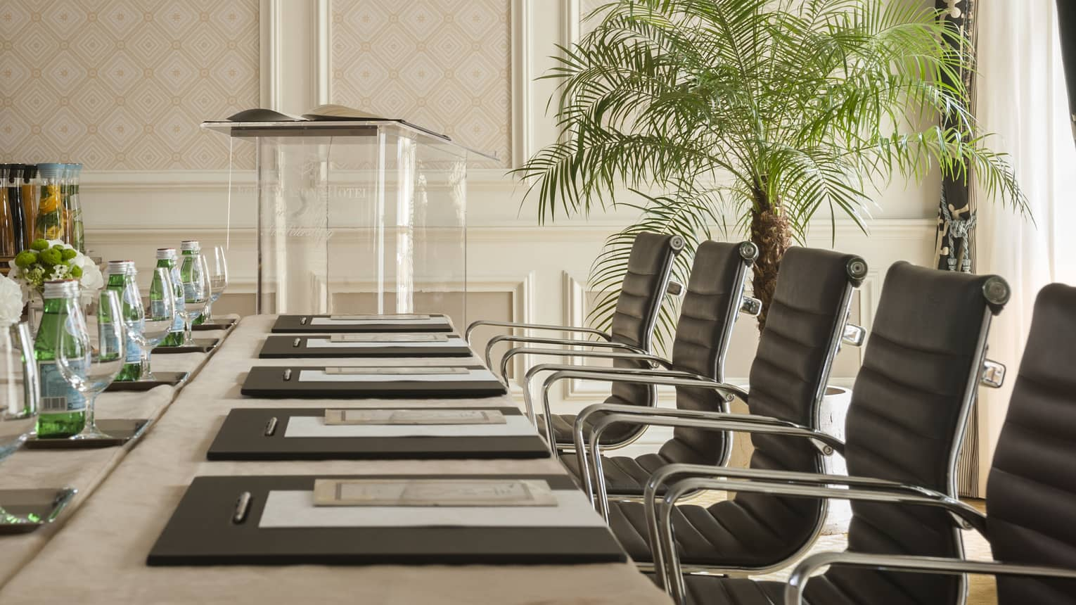 Phipps Room elegant boardroom meeting table lined with black executive chairs
