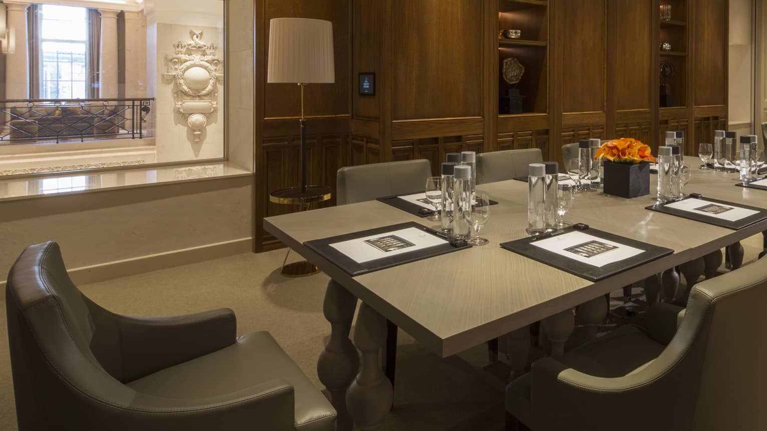 Serica Meeting Room two long boardroom tables with modern chairs, window to hall