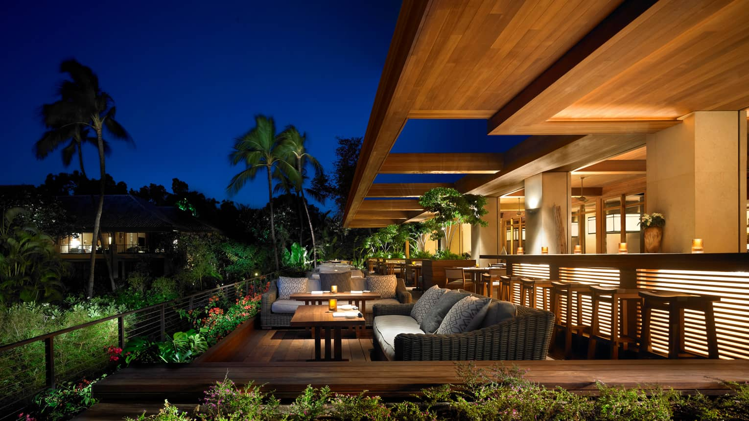 NOBU Lanai  restaurant patio lounge tables, bar with lights at night