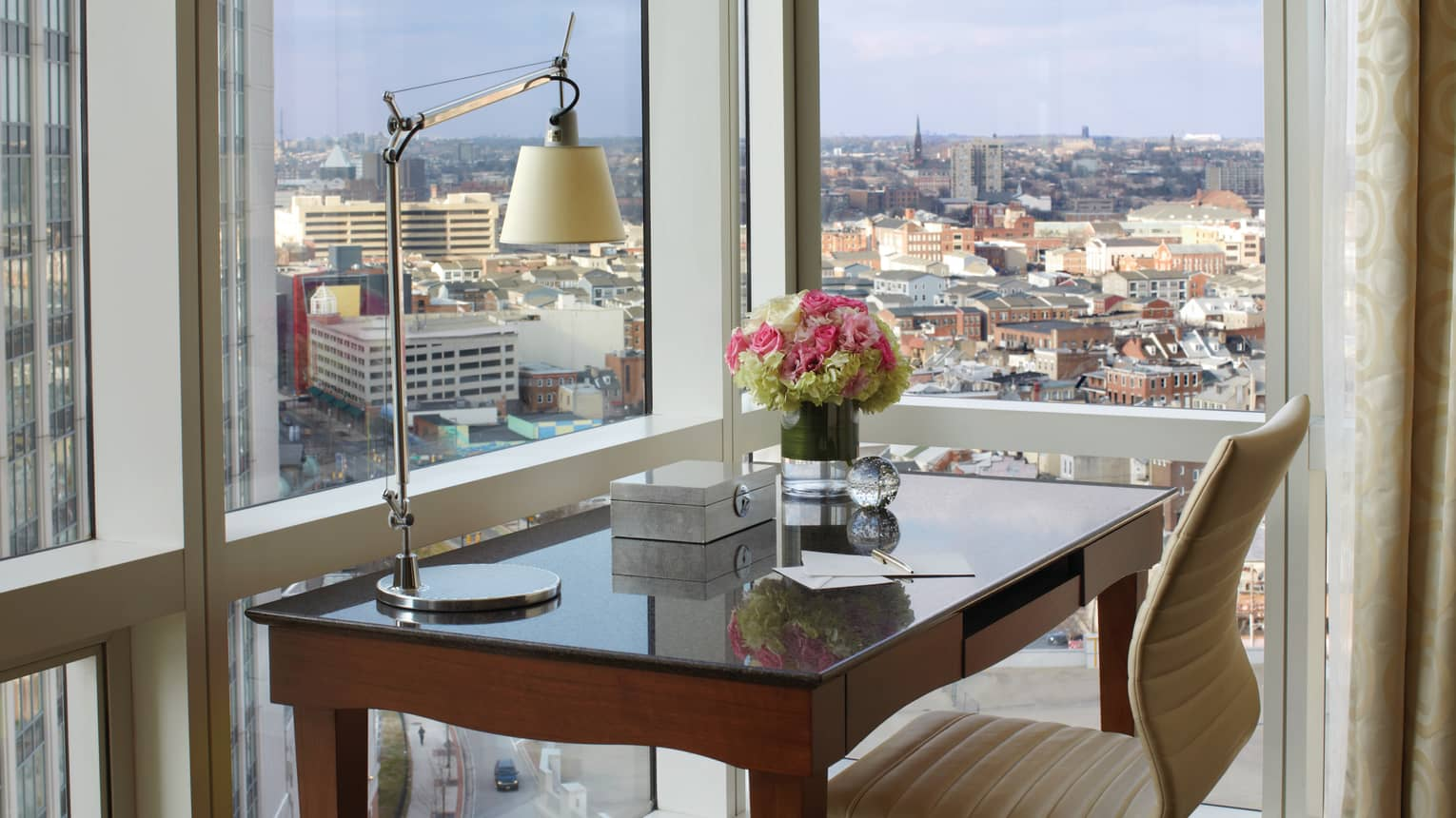 City-View Accessible Room writing desk with reading lamp, notepad, fresh flowers at window