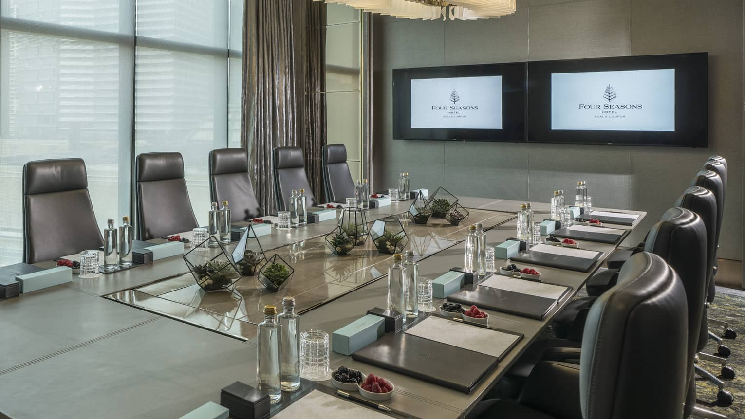 Private meeting room at Four Seasons Hotel Kuala Lumpur, featuring floor-to-ceiling windows