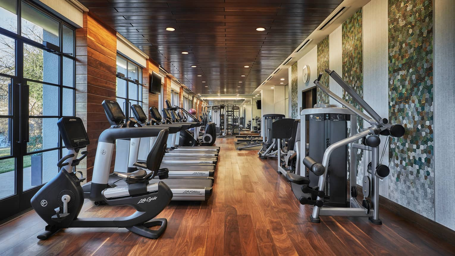Treadmills, cardio machines, weight stations line long Fitness Centre