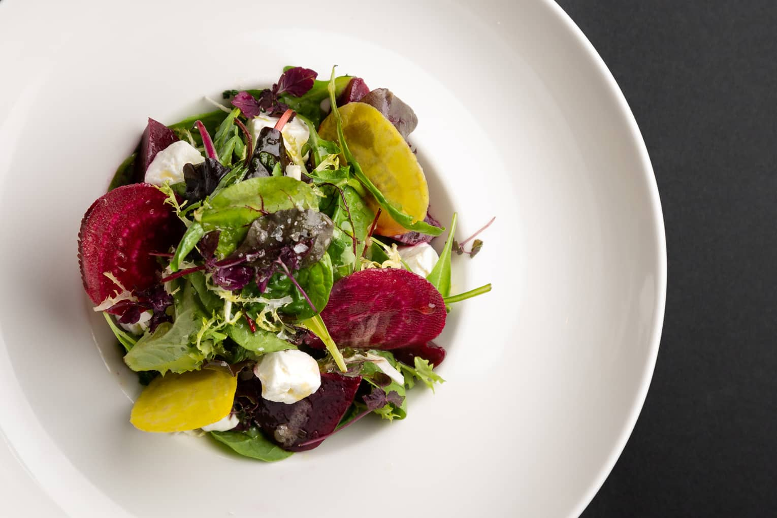 Red and gold beet salad with feta cheese, orange and pistachio